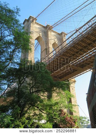 The Brooklyn Bridge Spans The East River And Is One Of The Iconic Bridges In The World.