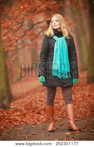 Autumn Time Concept, Leisure. Girl Is Walking Through The Park. Young Woman Speanding Free Time Outs