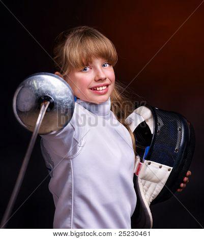 Child epee fencing lunge. Dark background.