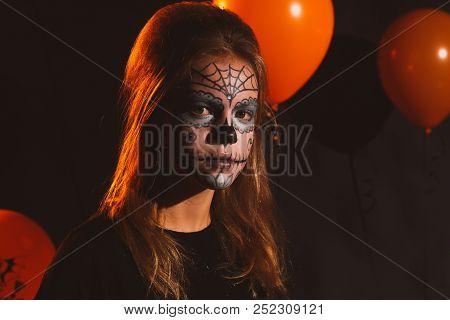 Happy Halloween Little Cute Girl Is Preparing For Halloween. Having Fun With Pumpkins On Kitchen Wit