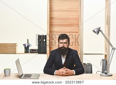 Portrait Of Bearded Businessman. Bearded Businessman Sitting At Table. Successful Businessman. Offic