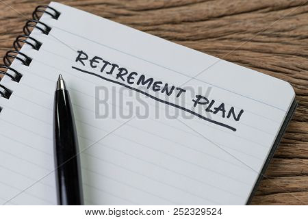 Blank Notepad With Pen And Handwriting Important Headline As Retirement Plan On Wood Table, Planning