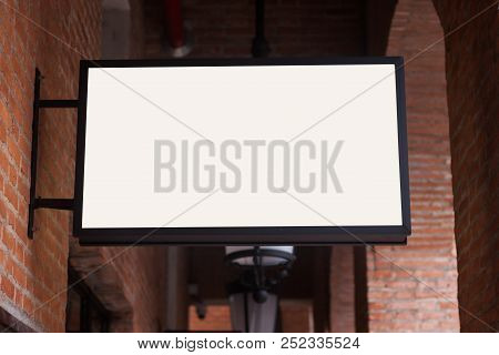 White Regtangle Signboard On The Brick Wall, Stock Photo