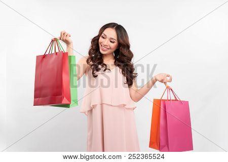 Happy Shopping! Young Woman Carrying Shopping Bags ,shopping Woman Holding Shopping Bags While Her F