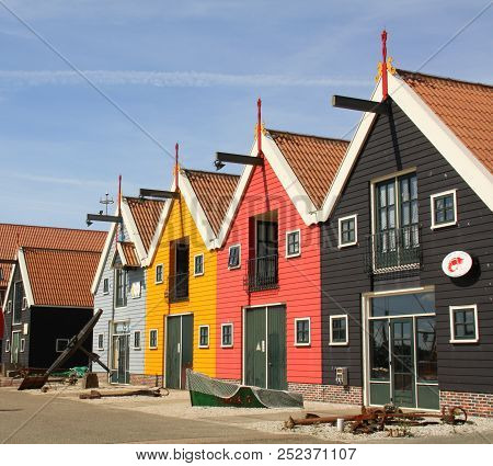 Zoutkamp. August-05-2018. Colored Warehouses In The Harbour Of The Fishing Village Zoutkamp. The Net