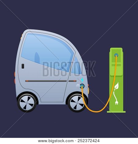 Beautiful Single-seat Electric Vehicle, Automobile Near City's Charging Electric Station.