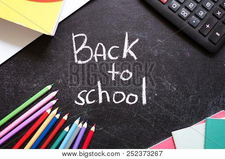School Stationery Around Back To School Words On Slate Black Background. Back To School Concept. Top