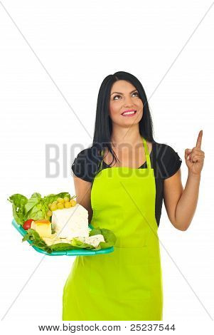 Smiling Cheese Maker Woman Pointing Up