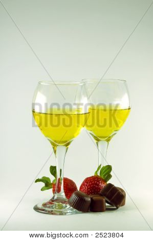 Two Wine Glasses With Strawberries And Chocolate