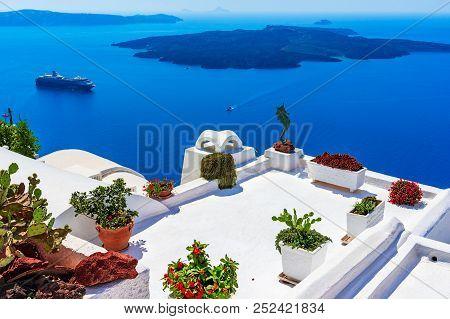 Santorini Island, Greece: Landmark Detail Of A Terrace Decorated With Flowers Over The Caldera Calde