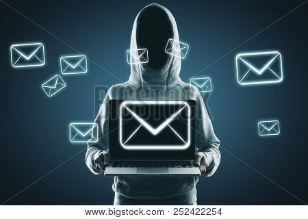 Hacker Holding Laptop With Digital Emails On Blue Background. Email And Hacking Concept