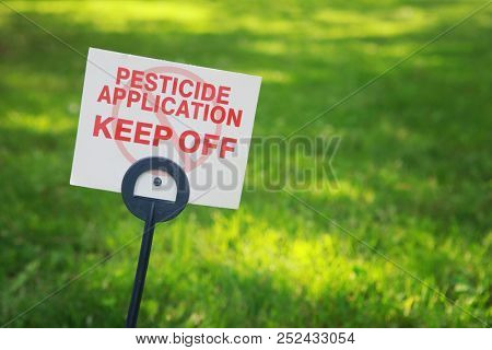 Pesticide applicaton sign with treated grass