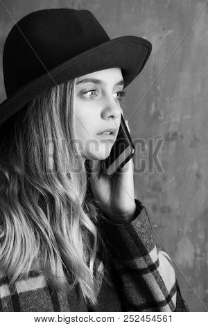 Caucasian Girl Speak Or Talking On Phone, Woman Hold Smartphone In Green Hat On Beige Background