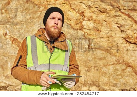Waist Up  Portrait Of Bearded Industrial Worker Wearing Reflective Jacket Inspecting Mineral Mines O