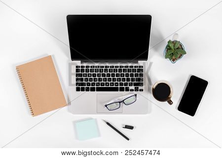 Office Table With Laptop Computer, Smartphone, Pen, Notebook And Coffee On Isolated Pure White Backg