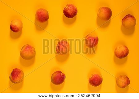 Many Juicy Beautiful Amazing Nice Peaches On Yellow Surface. Beautiful Food Art Background. Top View