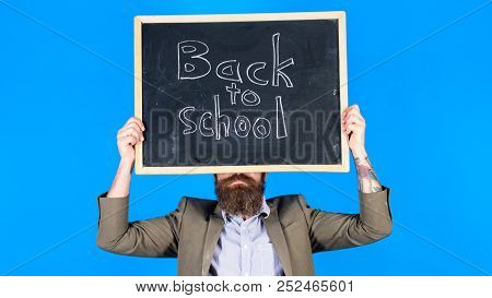 Teacher Informs About School Year Beginning. Teacher Bearded Man Holds Blackboard With Inscription B