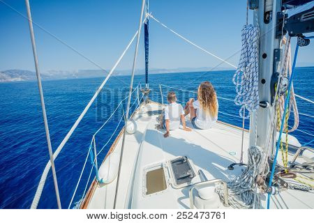 Back View Of Boy With His Sister On Board Of Sailing Yacht On Summer Cruise. Travel Adventure, Yacht