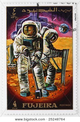 FUJAIRAH - CIRCA 1979: A stamp printed in The Fujairah shows The Neil Armstrong and Edwin Aldrin it is the first persons to set foot on the surface of the moon with spaceship Apollo 11, circa 1979.