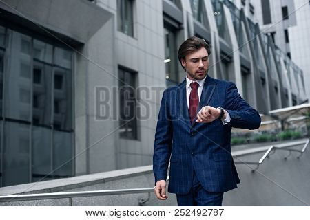 I Should Be There In Time. Confident Businessman. Confident Young Man In Full Suit Standing Outdoors