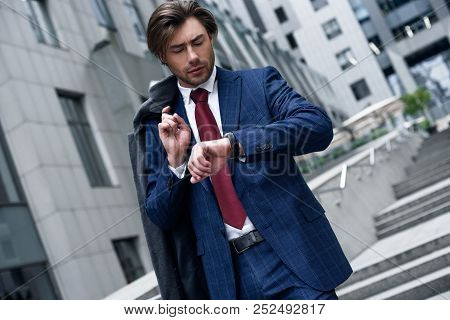 I Should Be There In Time. Confident Businessman. Confident Young Man In Full Suit Adjusting His Sle