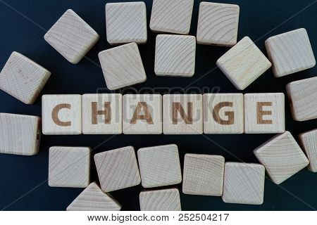 Personal Change, Business Transform Or Evolve Concept, Cube Wooden Blocks Building The Word Change O