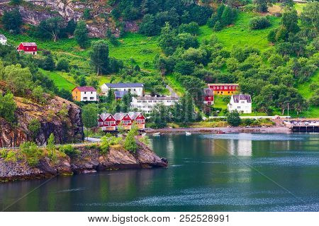 Norwegian Fjord Village And Sognefjord Landscape In Flam, Norway. Tourism Vacation And Travel Backgr
