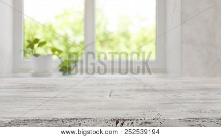 Bleached Vintage Wooden Tabletop With Blurred Window For Product Display