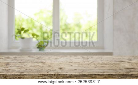 Brown Aged Wooden Tabletop With Blurred Window For Product Display
