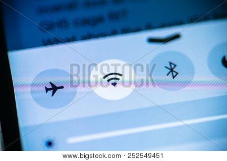 Paris, France - Nov 14, 2015: Wifi, Flight Mode, Bluetooth Icons On The Phone Smartphone Device Tabl