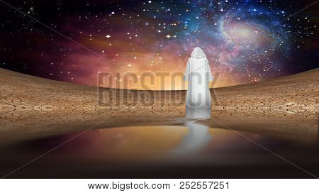 Desert and galactic sky with wandering cloaked figure. 3D rendering