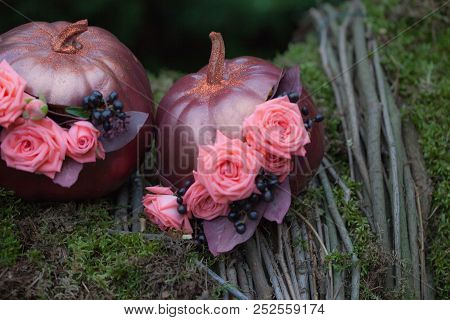 Autumn Décor With Bouquet Of Roses And Grapes In The Golden Pumpkin. Stylish Halloween Decorations.