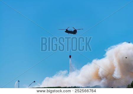 Hengelo, Netherlands - July 1, 2018: Dutch Chinook Army Helicopter Extinguishes A Large Fire At A Lo
