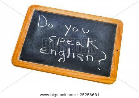 sentence do you speak english? written with chalk on a blackboard