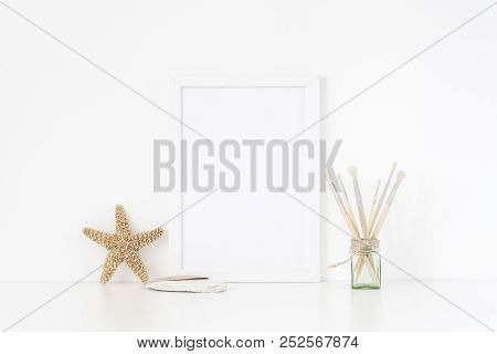 Stylish Sea White Frame Mockup A4 In Interior. Frame Mock Up Background For Poster Or Photo Frame Fo