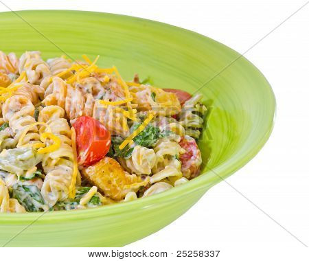 Cheesy bacon, lettuce and tomato pasta salad isolated on white