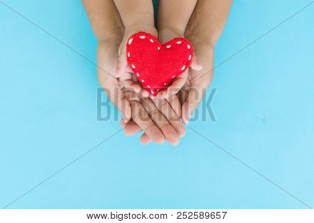 Top View Of Adult And Child Holding Red Heart In Hands, Happy Family Relationships, Valentine's Day,