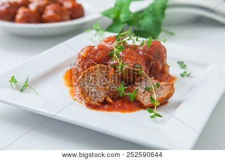 Seitan Or Tofu Meat With Tomato Sauce On Plate