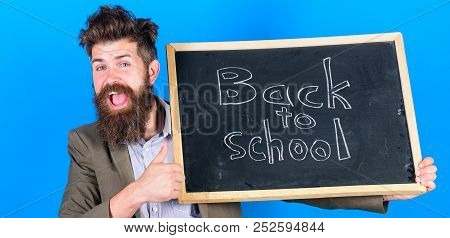 Teacher Bearded Man Holds Blackboard With Inscription Back To School Blue Background. Beginning Of N