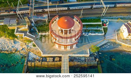 Drone View Of The Matsesta Marine Station Near The Railroad With A Train In Sunny Summer Day, Sochi,