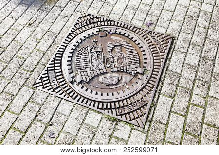 Trondheim, Norway - September 30, 2016: A Trondheim Manhole Made Of Cast Iron With Attached Cover Di