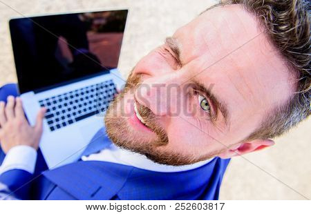 Man Smiling Cheerful Face Work With Laptop Close Up. Pleasant Workday Outdoors. Sunny Summer Day Gre