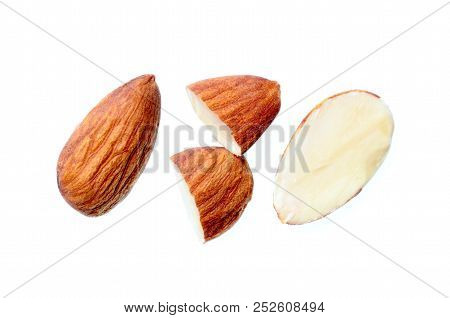 Full And Half Cut Almond Nut Isolated On White Background, Seed Pattern, Macro Detail Of Grain Textu