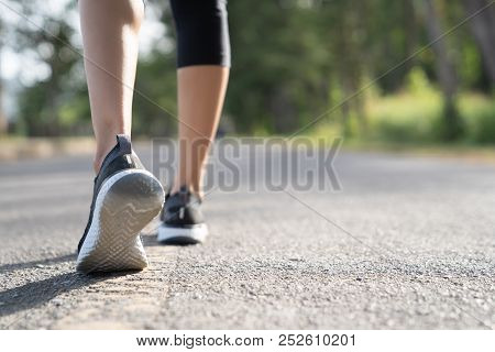Runner Feet Running On Road Closeup On Shoe. Woman Fitness Sunrise Jog Workout Welness Concept. Youn