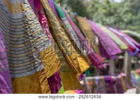Hand Woven Clothes Hang On Wooden Walkways In Rice Field At Sila Laeng, Pua District, Nan, Thailand