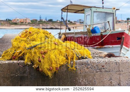 Fishing Nets, Buoys And Floats With Fishing Boat