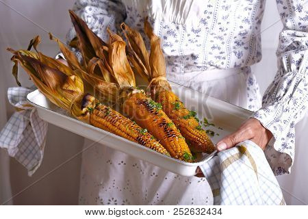Baked Corn On A Baking Tray With Salt And Parsley