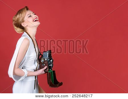 Photographer. Woman In Retro Style With Vintage Photo Camera. Attractive Girl In Retro Dress Holds O