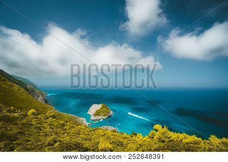 Zante Fantastic Coastal View With White Cliff And Azure Sea Water. White Tourist Ship Sailing Full S