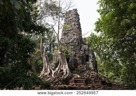 Ancient Ruins Of Preah Palilay Temple In Angkor Wat Complex, Cambodia. Demolished Hindu Temple With